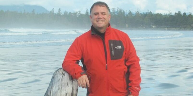 A picture of Gord Johns by the water