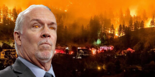 A picture of John Horgan superimposed over a forest fire with houses burning. His eyes are erased to show the flames behind him.