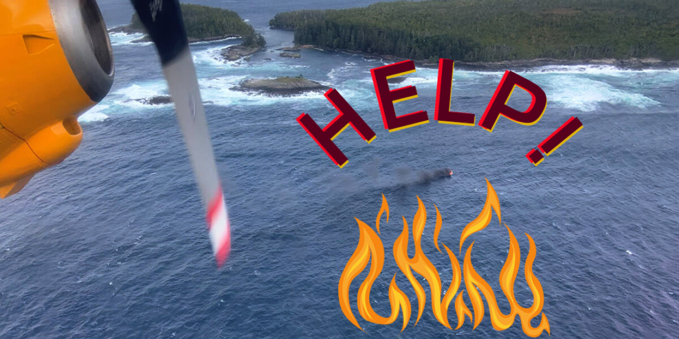 An aerial shot of the boat on fire with a bit of the plane's propeller in view.
